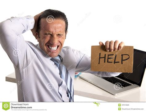 desperate senior businessman in crisis working on computer