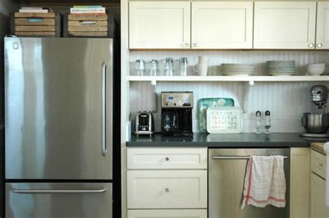 shalllow shelf under cabinets gets stuff off counter open shelves under an upper cabinet