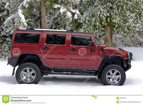 snow hummer road hummer h2 in the snow stock image image 4203759