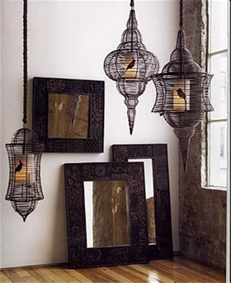 Hanging Bird Cages From Ceiling by Bird Cage Lanterns Hanging From Ceiling Hooks Above Tub