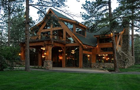 a post and beam entry to a smaller mountain lodge style