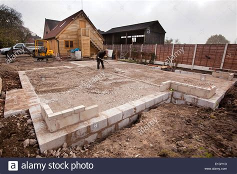 how to lay a foundation for a house self building house levelling foundation infill with compacted mot stock photo