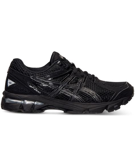 asics black sneakers lyst asics s gt 1000 3 running sneakers from