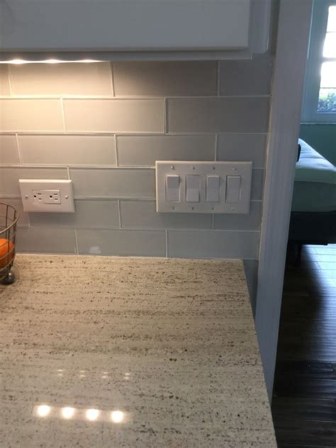 outlet cover plates on glass tile backsplash