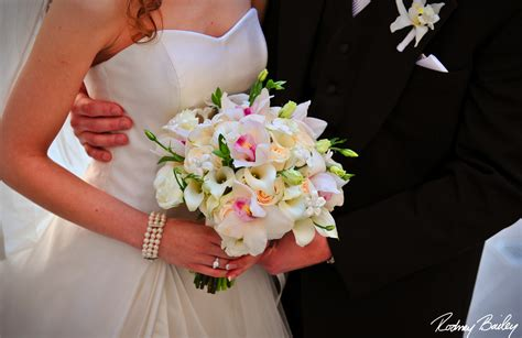 wedding bouquet lilies and orchids white mini calla lilies with cymbidium orchids bridal