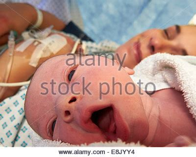 fluid in baby lungs after c section cesarean section child birth stock photo royalty free