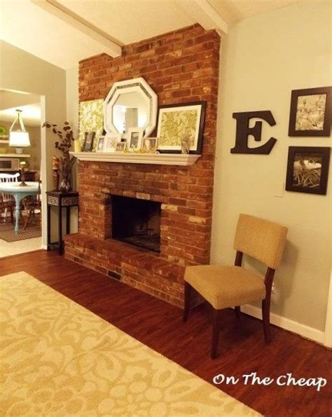 How To Hang A Mantle On A Fireplace by White Mantel Brick Fireplace How To Drill Into A Brick
