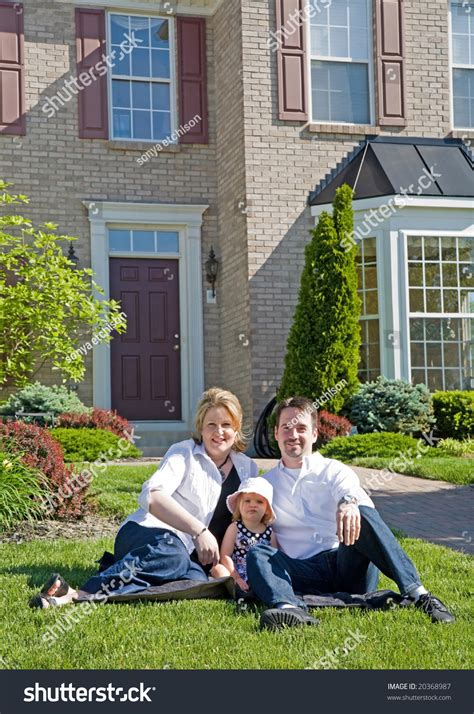 their home happy family in front of their home stock photo 20368987