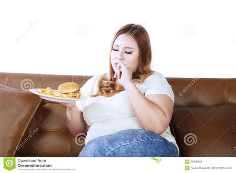 woman eats couch obese woman eating a junk food stock photo image 85086525