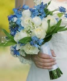 blue flowers for wedding brides bridesmaids blooms foucus on shades of blue brides blooms