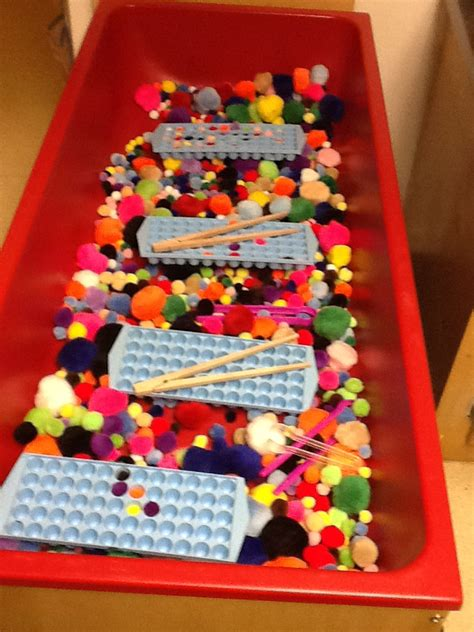 playfully learning sensory table idea pom poms