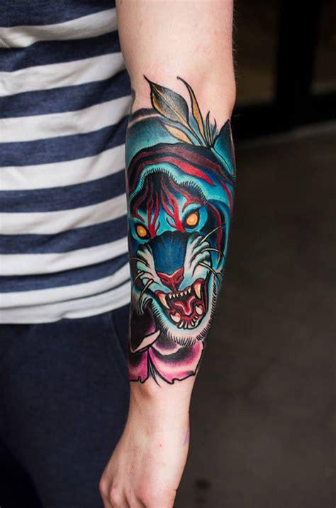 blue tiger tattoo on arm
