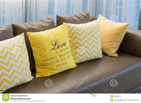 yellow pillows for sofa living room with brown sofa and yellow pillows stock photo