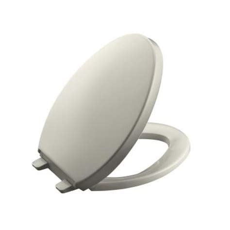 kohler saile elongated closed front toilet seat in biscuit