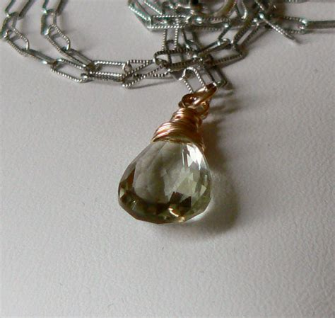 mixing gold and silver green amethyst gold and silver mixed metal wire wrapped charm