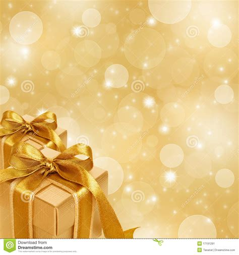 wallpaper abstract gift gold gift box on abstract gold background stock image