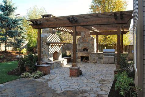 austin stone patio pergola on stone with fireplace