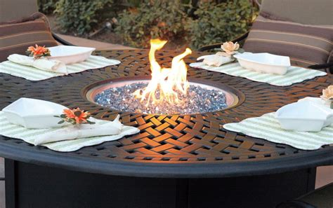 fire pit in the center of the outdoor table apartment