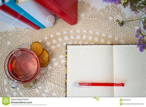 open notepad and cup of tea stock photo cartoondealer