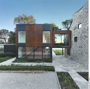 modern steel cubes complement 200 year old stone house