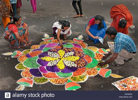 themes for rangoli making chennai woman is making an rangoli design with flowers in