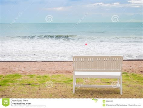 bench on the beach bench on the beach royalty free stock photography image 30522927