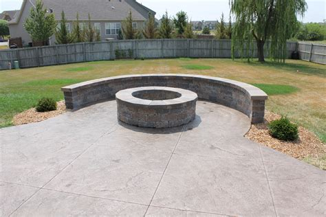 make your backyard cozy with concrete pit fireplace