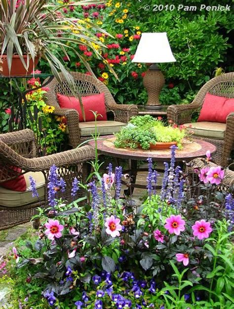 cottage garden patio cottage garden patio with wicker furniture and an