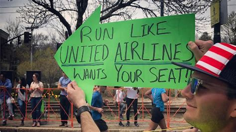 united airline sign in this boston marathon sign brilliantly trolls united airlines
