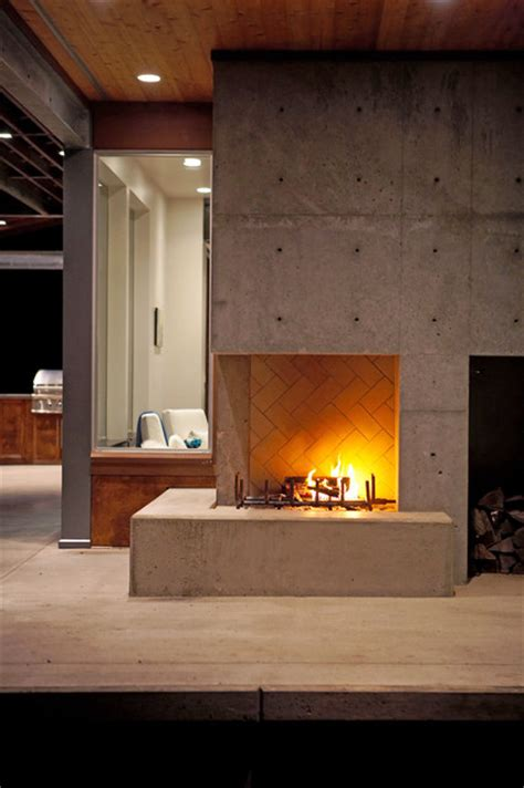 outdoor fireplace at dusk modern patio seattle by