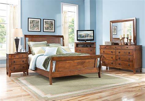 rooms to go sleigh bed bedford pines brown 5 pc king sleigh bedroom bedroom sets wood
