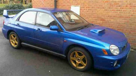 blue subaru gold rims subaru 2001 impreza wrx wr blue gold wheels 60500 miles
