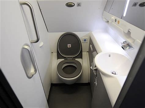 how to use bathroom in flight passenger where does my pee go when i flush at 35 000 ft