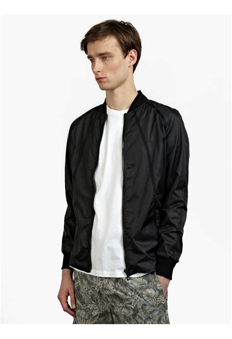 light bomber jacket mens christopher raeburn s black lightweight bomber jacket
