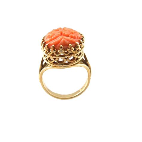 14k gold carved coral ring from cometiques on ruby