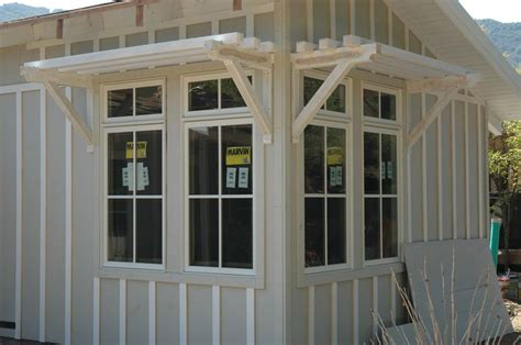 marvin clad ultimate double hung windows stone white exterior   simulated divided grids