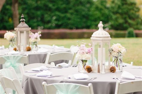 lanterns with flowers centerpieces white lantern centerpieces with pastel flowers