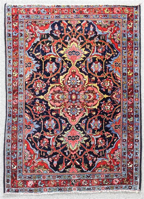 This Plate Is A Rug by A Kirman Rug Woven With A Bold Plate Central Medallion Trai