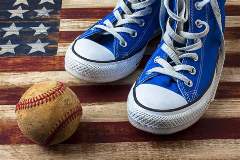 blue tennis shoes and baseball photograph by garry