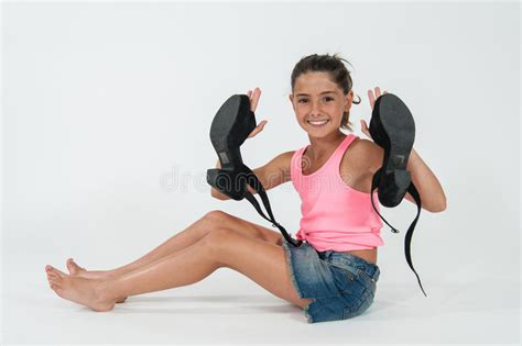 preteen little play little girl wearing the shoes of mom stock photo image