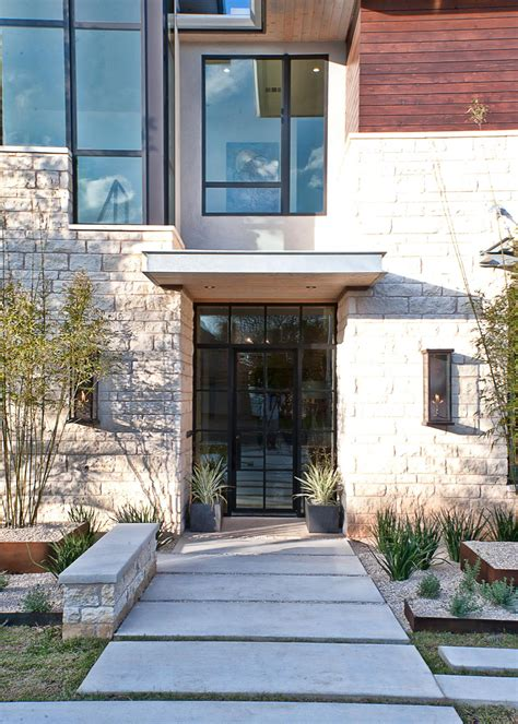 cornerstone architects light filled home with stone walls and unique style