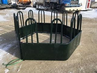 unreserved online auction cattle squeeze bale feeders