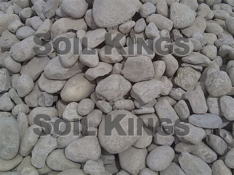 river rock 4 12 delivery only soil