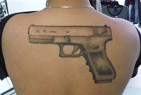 big gun tattoo on back