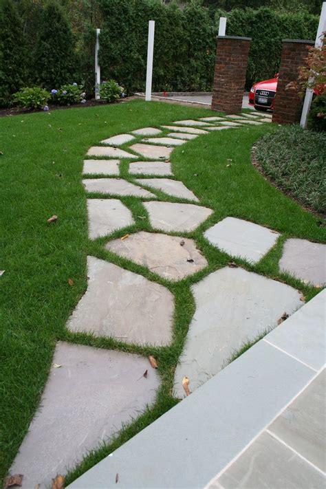 irregular bluestone path set  lawn irregularbluestone