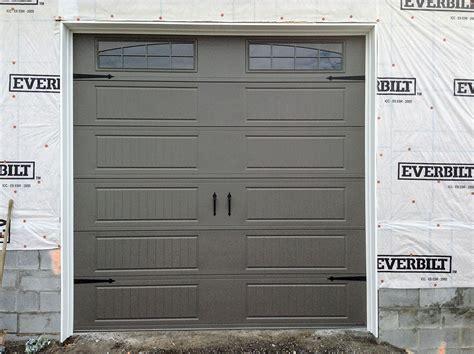 garage construction with tk ventures doors in carroll