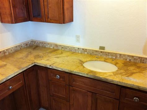 solid surface counter top with mosaic backsplash stocker