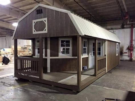 this tiny shed has been turned into a functioning home