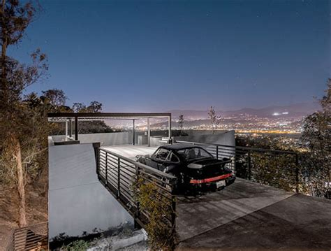 house car parking designs house in reverse rooftop driveway leads to hillside home