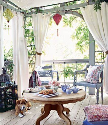 renaissance themed living room living area patio unit the villa outdoor dining porch curtains white grey moroccan lantern